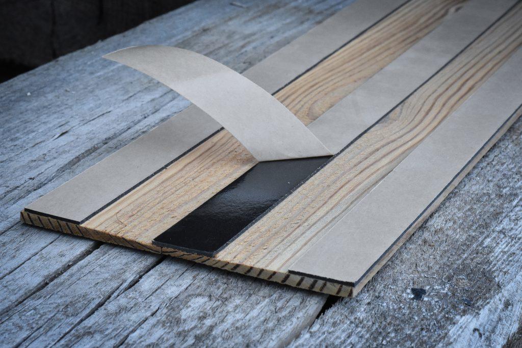 Adhesive on veneer barnboard.